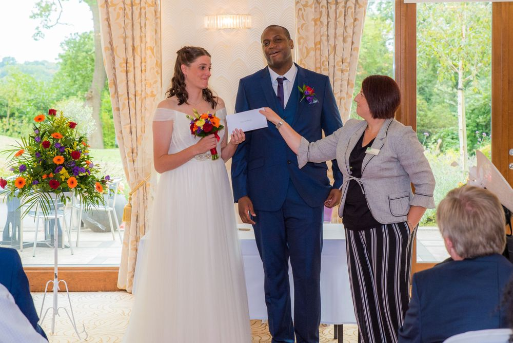 handing over the official wedding certificate at Bromley Court Hotel