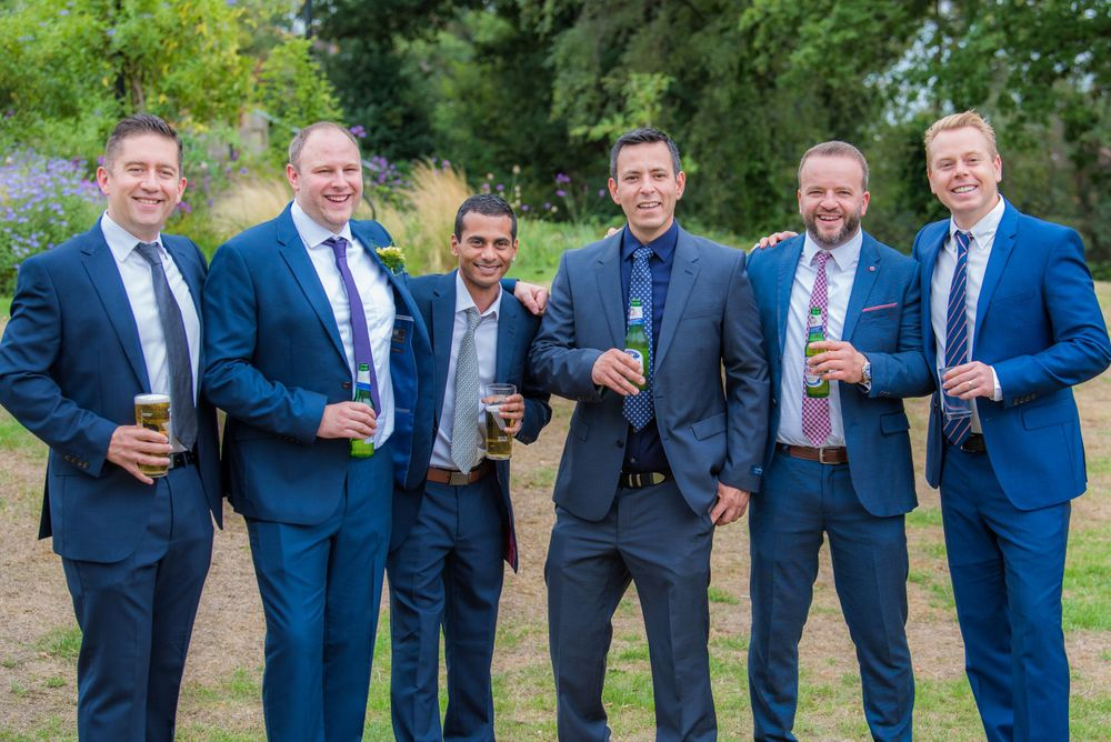 all the groomsmen standing together at Bromley Court Hotel