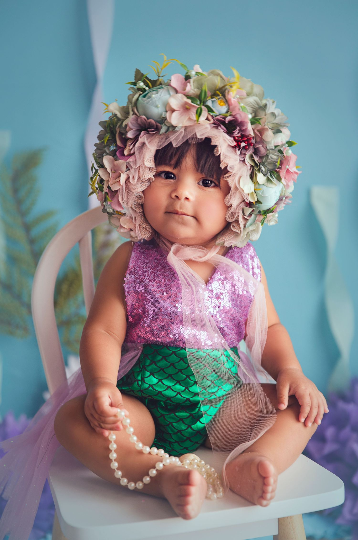 big floral bonnet on baby under the sea theme