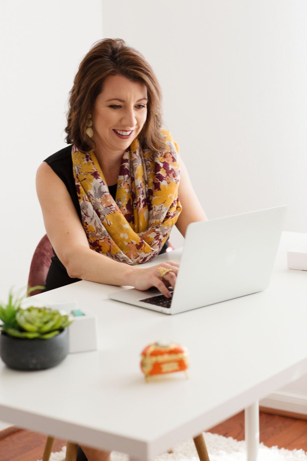 Personal brand photography for virtual assistant in white office