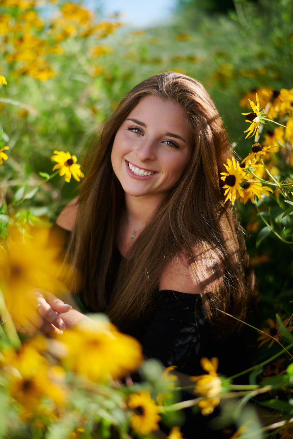 Senior picture in flowers near Sibley State Park
