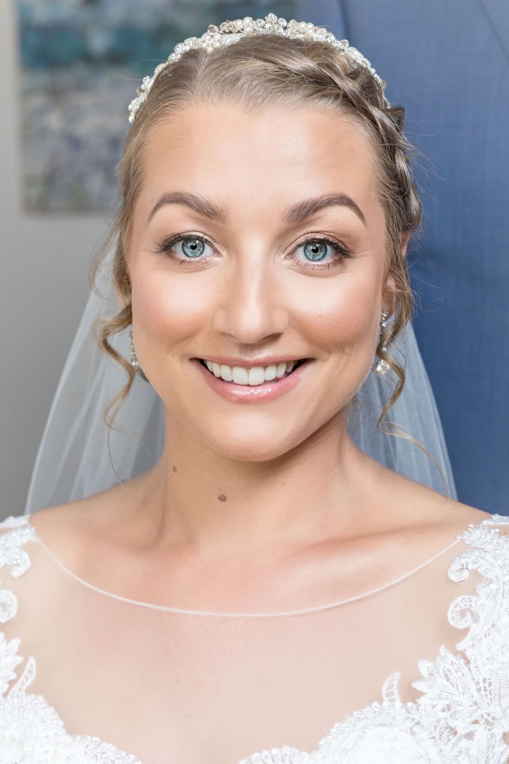 Image of smiling bride's face.