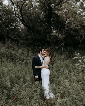 Toronto bride and groom embracing after their wedding first look in a forest.