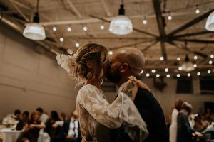 Toronto wedding couple during their first dance at Airship37. Bride is wearing Rue de Seine wedding dress.
