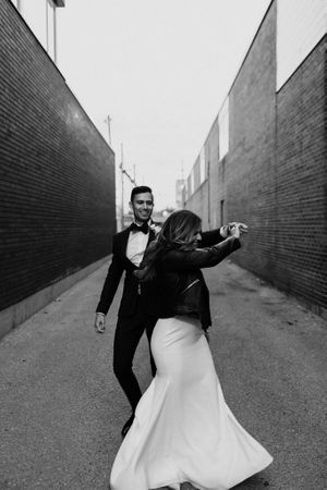 Toronto bride and groom dancing in alleyway at District 28.