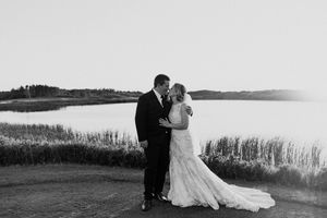PEI wedding at Rodd Crowbush. Black and white photo of couple embracing at sunset.