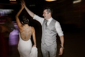 Toronto bride and groom dancing the night away at Evergreen Brick Works. Groom is making bride twirl.