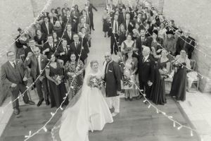 Wedding party and guests at Kingscote Barn