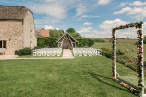 Outside ceremony Kingscote Barn