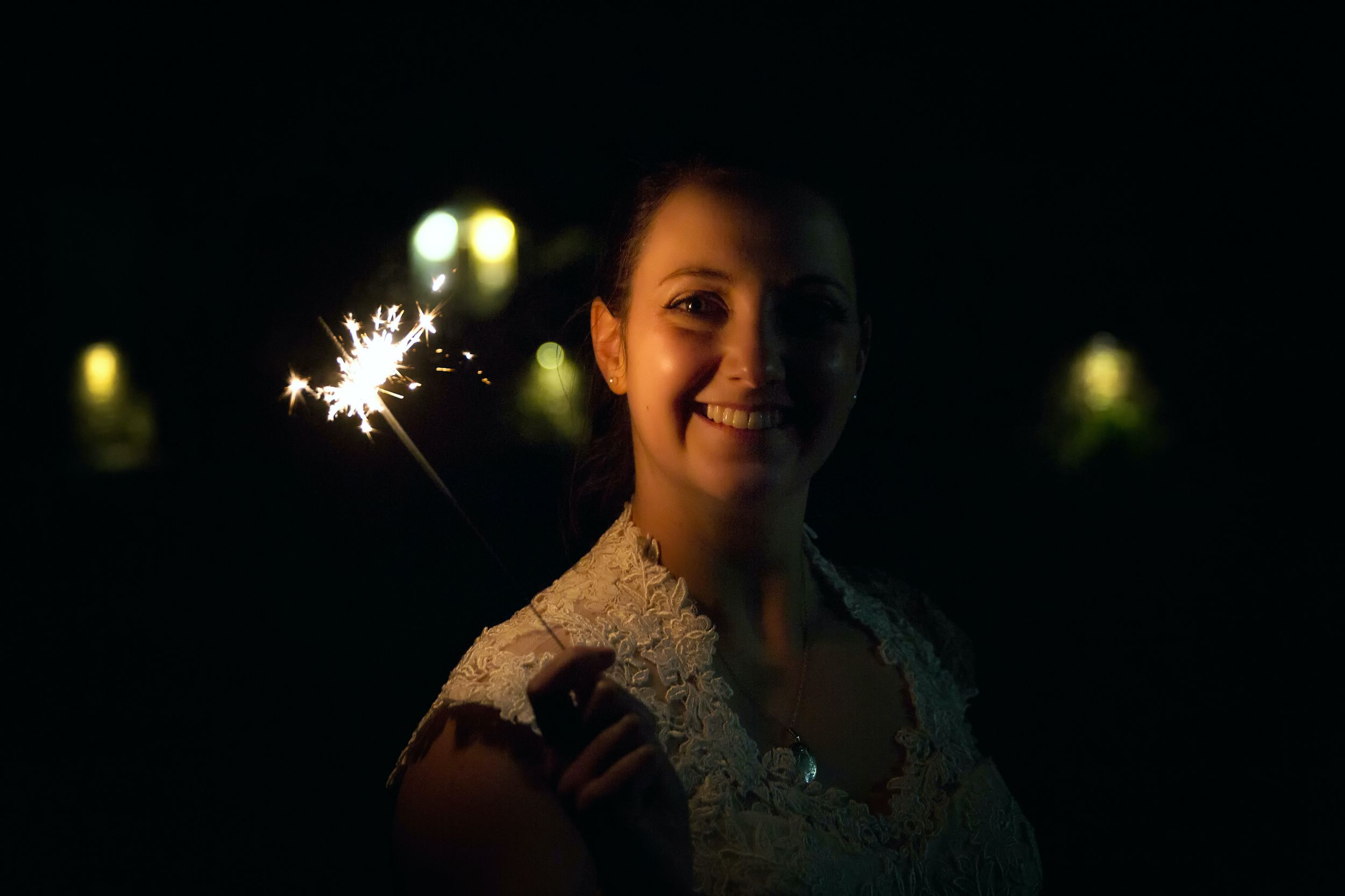 Bride with sparkler Cotswold Wedding Great Tythe Barn Tetbury