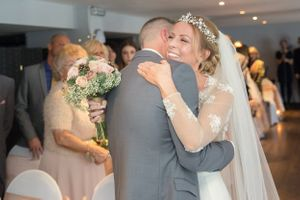 Embrace for wedding couple at Cadbury House