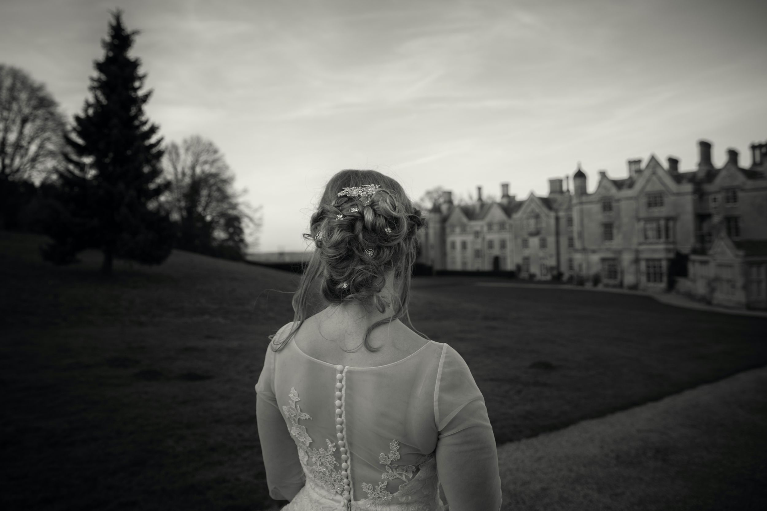 Bride looking towards Dumbleton Hall