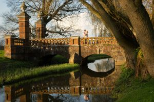 Couple on bridge at The Elvetham Wedding