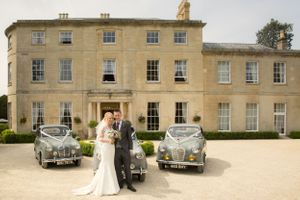 Classic cars with bride and groom at Eastington Park
