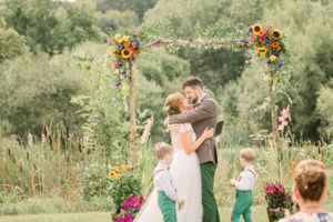 Outside ceremony with flower arch