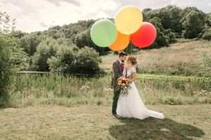 Wedding couple with colourful balloons