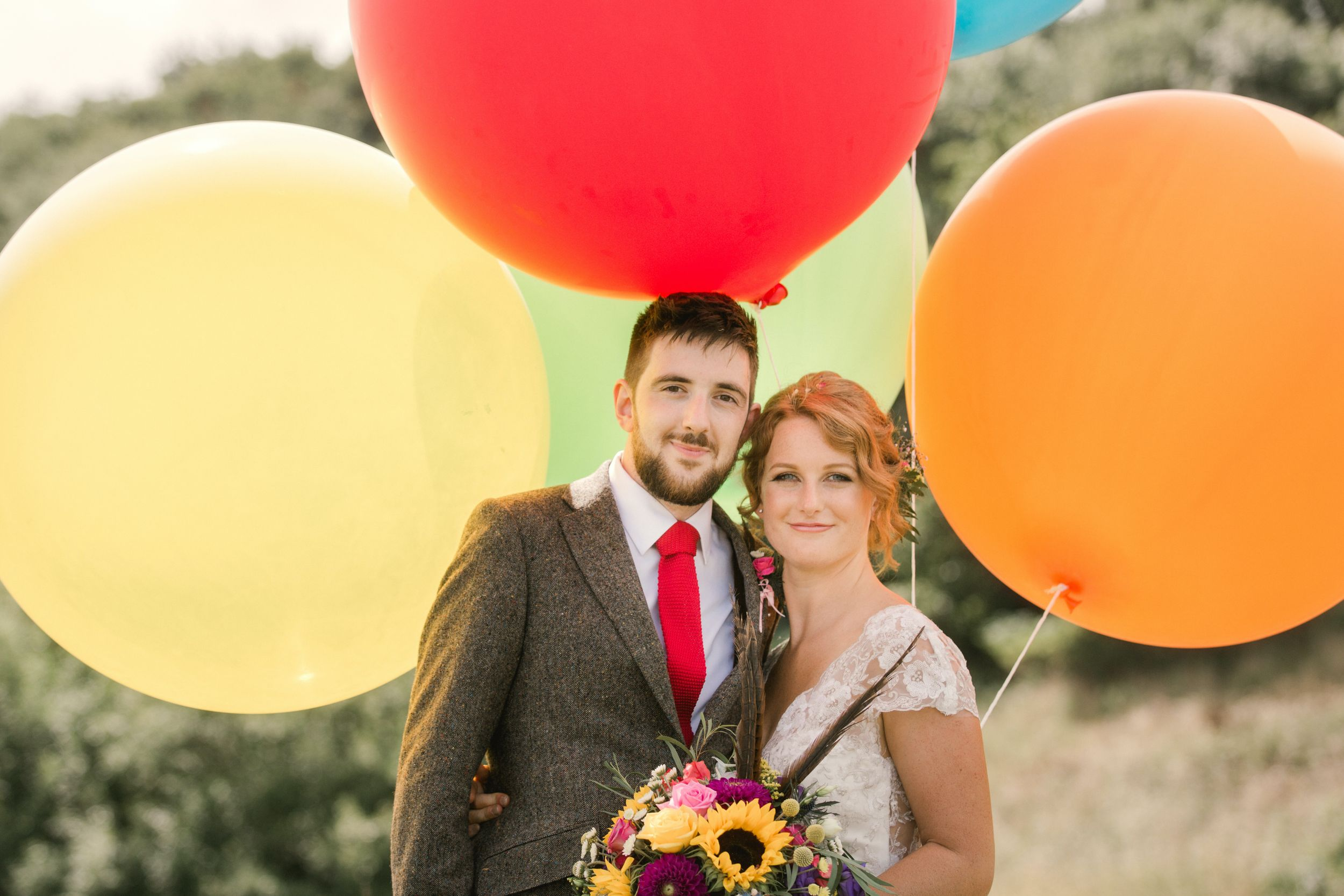 Bride & Groom with balloons Cotswolds Wedding
