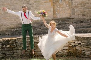 Jumping for joy bride & groom wedding gloucestershire