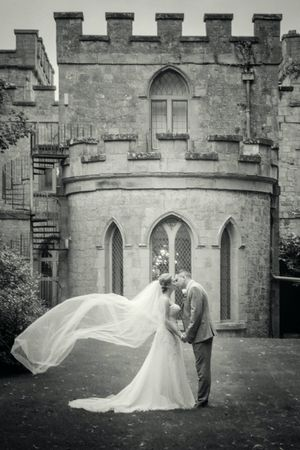 Bride & Groom at Clearwell Castle flowing veil