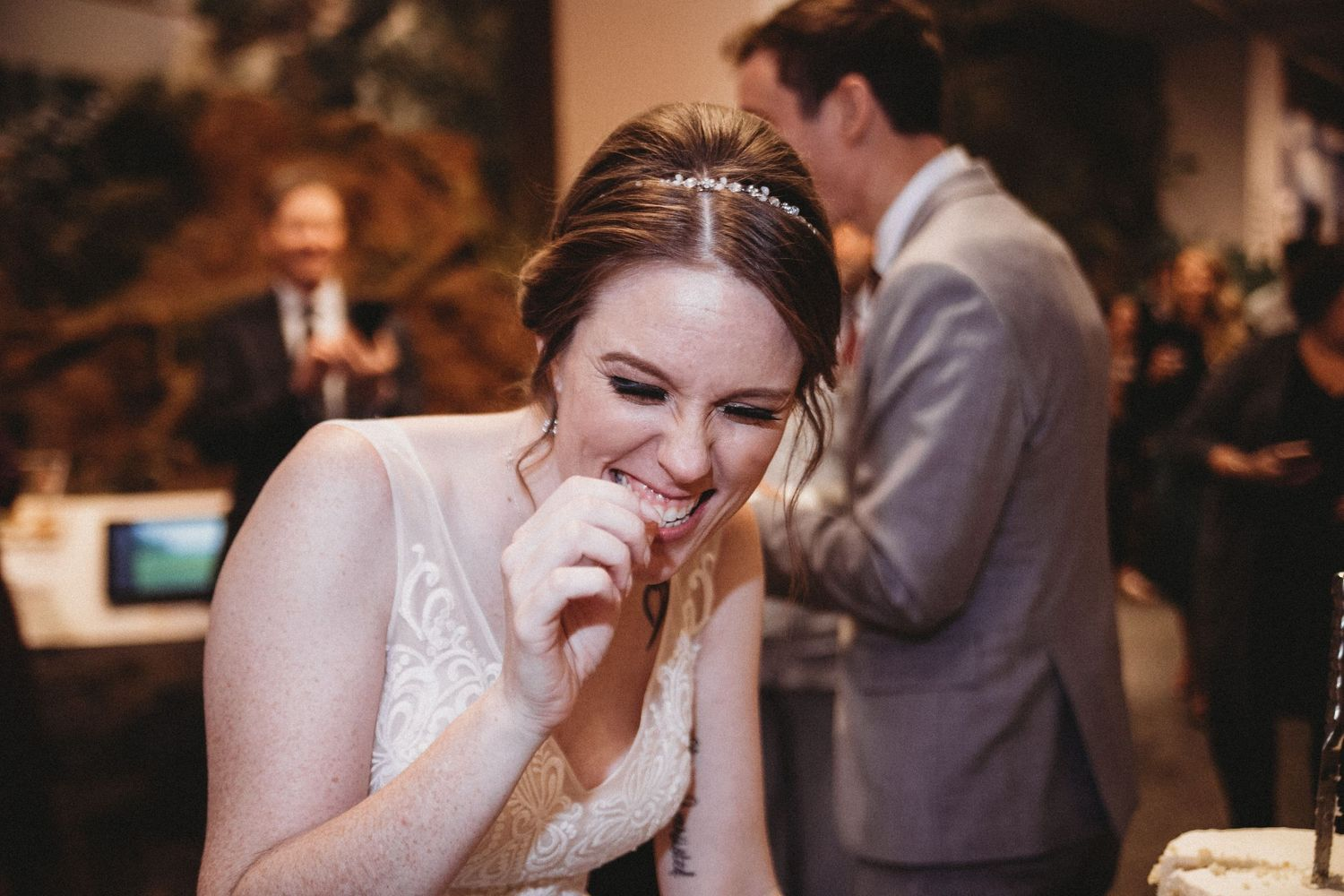 bride sneaking another slice of cake without anybody watching