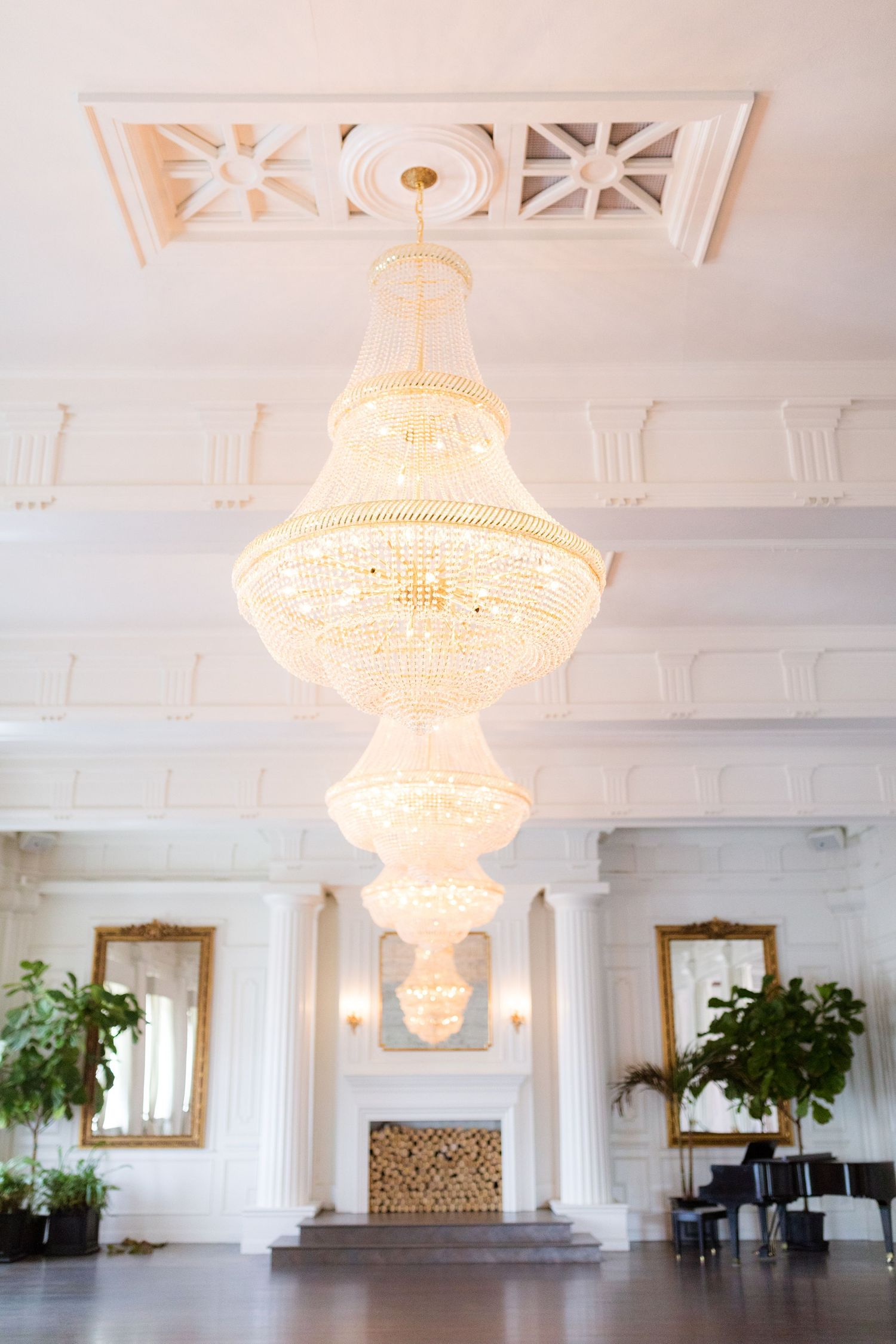 Sparkling chandeliers in the ballroom at The Mason Dallas.