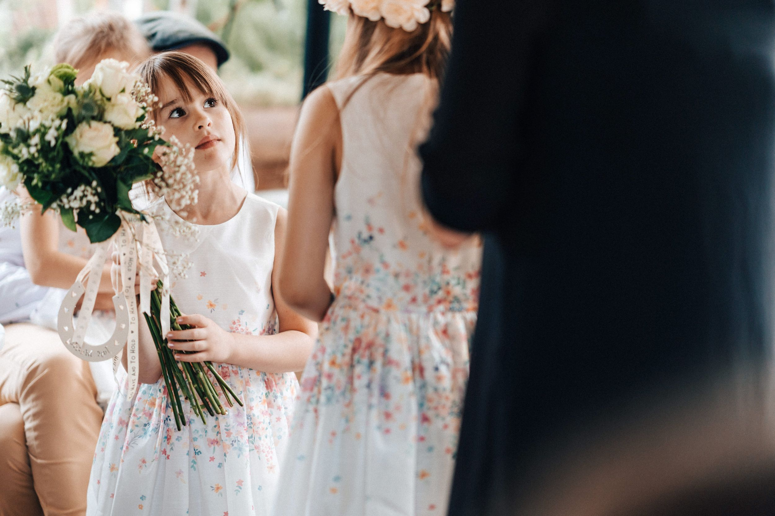 Reportage photograph taken at 131 Cheltenham a flower girl having fun holding her flowers
