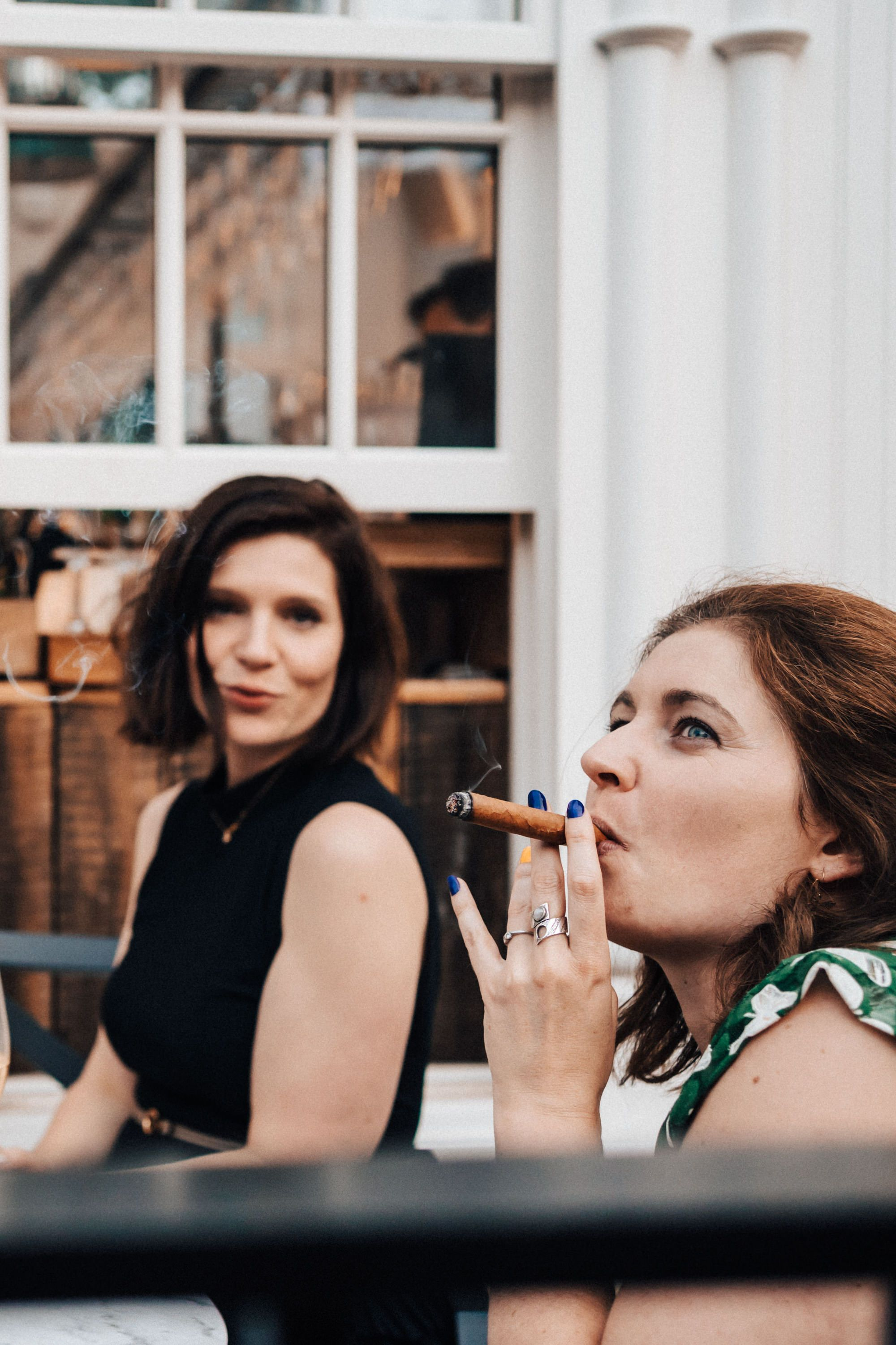Wedding guest smoking a cigar at Wedding at 131 Cheltenham funny photograph reportage