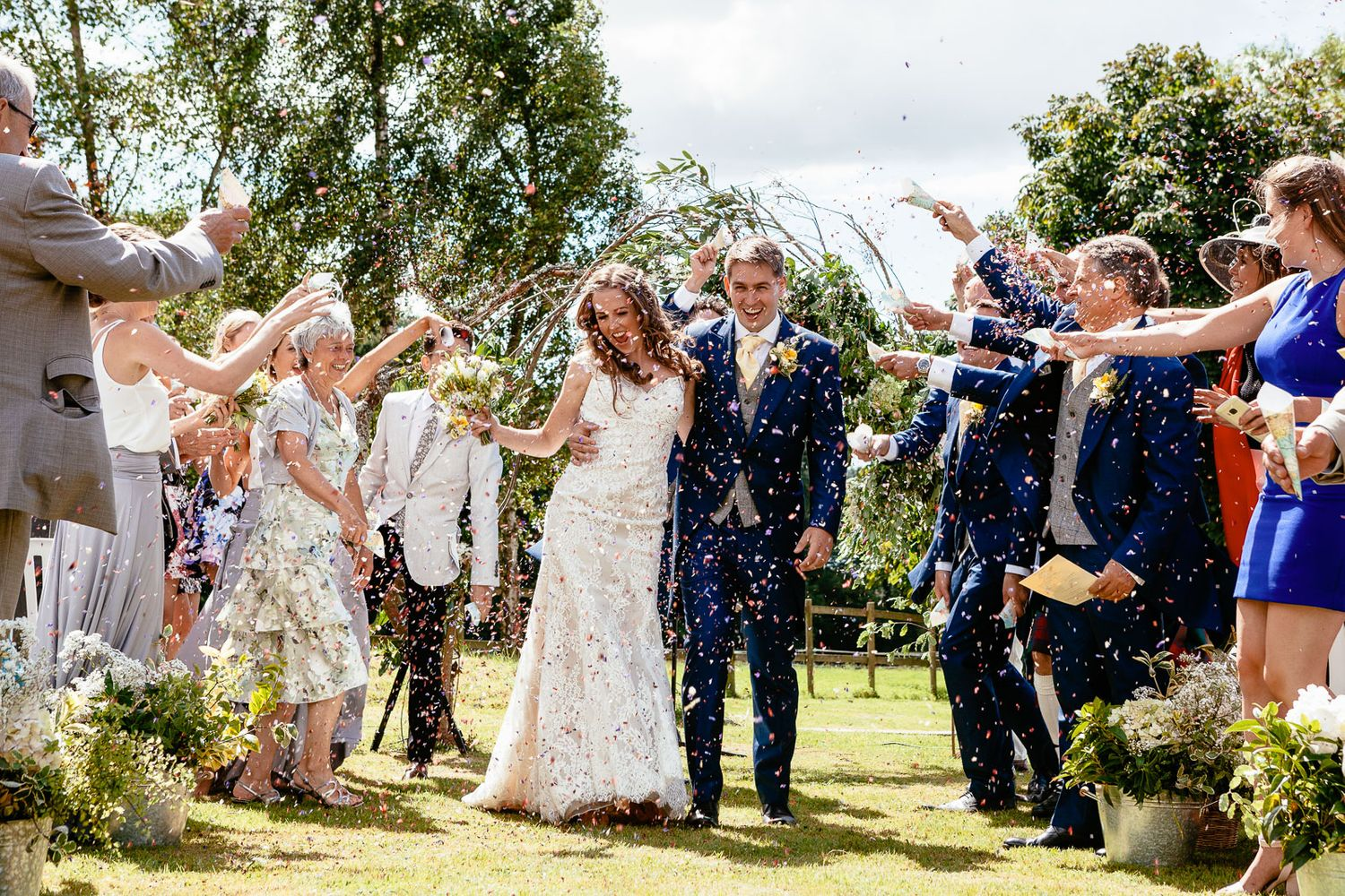confetti at outdoor Devon wedding by destination wedding photographer Elizabeth Armitage