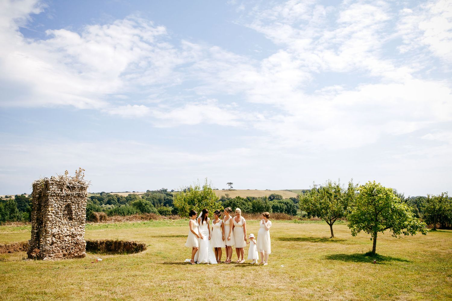 bridesmaids on a sunny day by Tuscany based wedding photographer Elizabeth Armitage