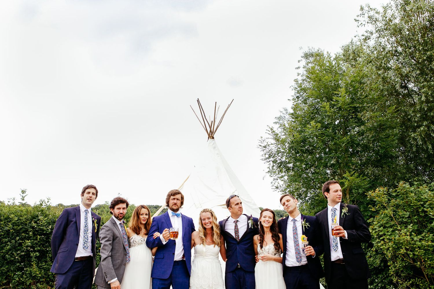 Devon festival wedding bridal party in front of tipi