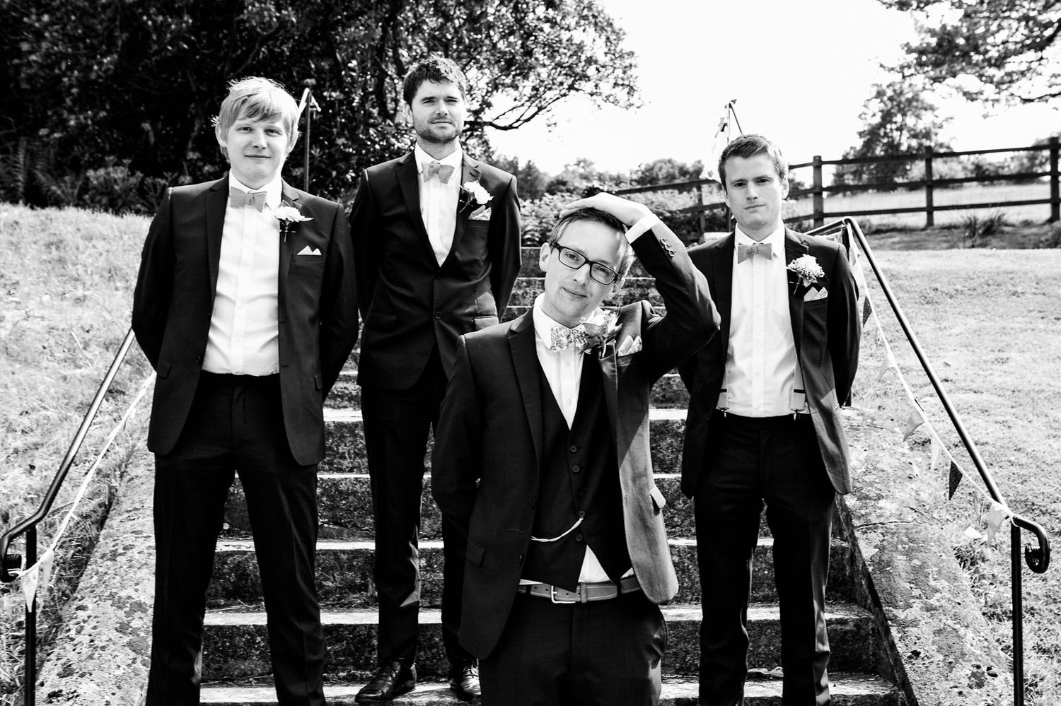 black and white photography of groomsmen by Tuscany based wedding photographer
