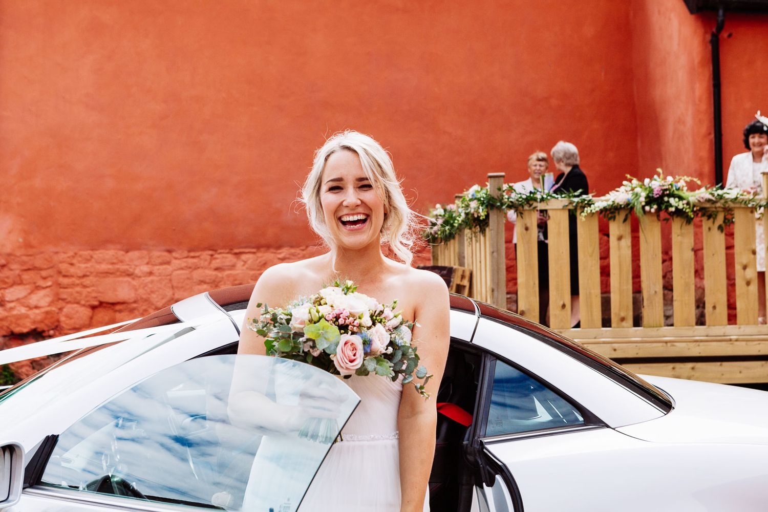 photography of bride arriving to wedding ceremony in Exmouth Devon