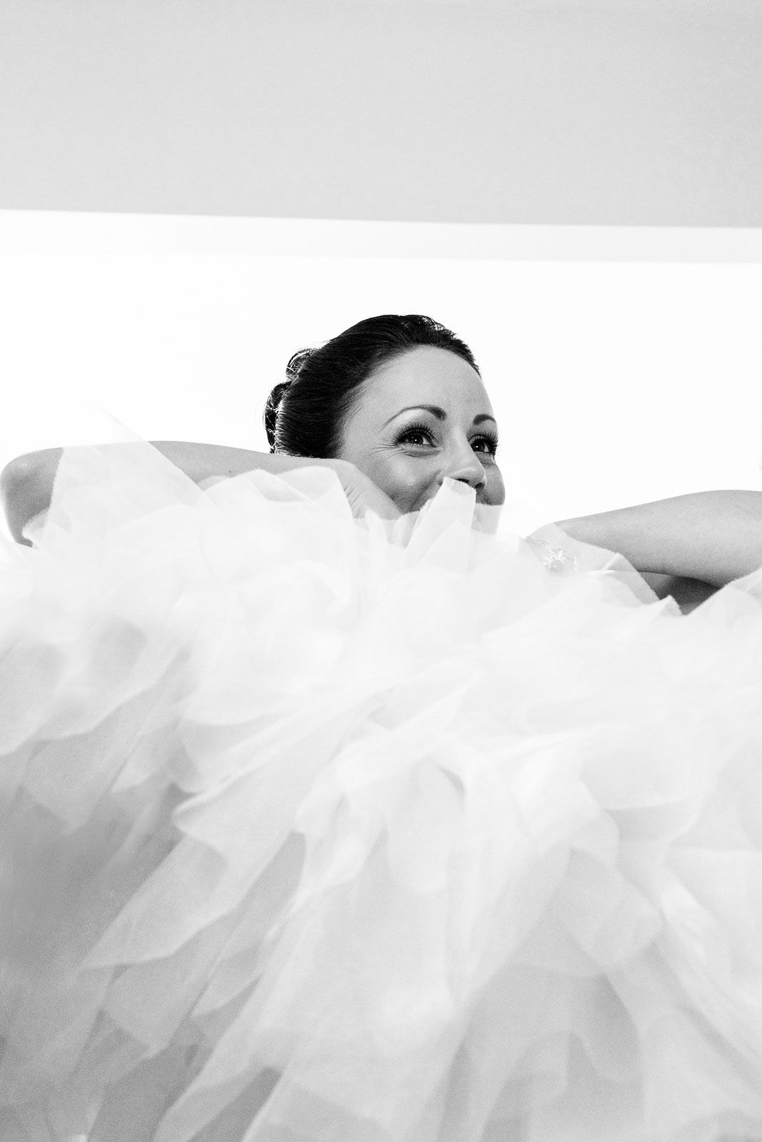 getting into your wedding dress. by Elizabeth Armitage, Tuscany based wedding photographer