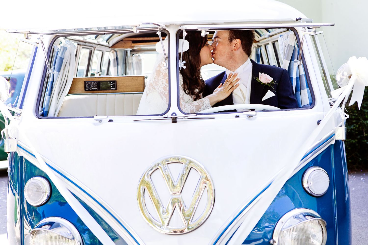 couple kissing in VM camper van at Devon wedding