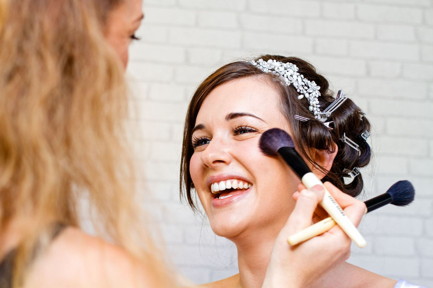 happy bride getting ready. bridal preparation photos