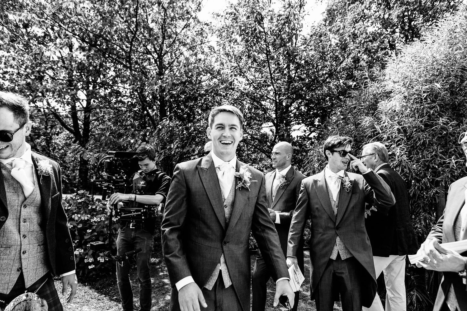 natural wedding photography of groomsmen by Tuscany based wedding photographer