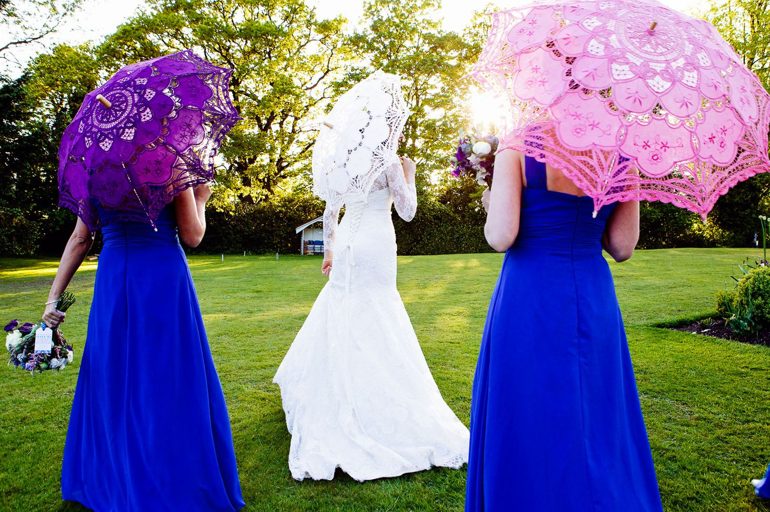 creative wedding photography of bridesmaids with parasols by Italy destination wedding photographer