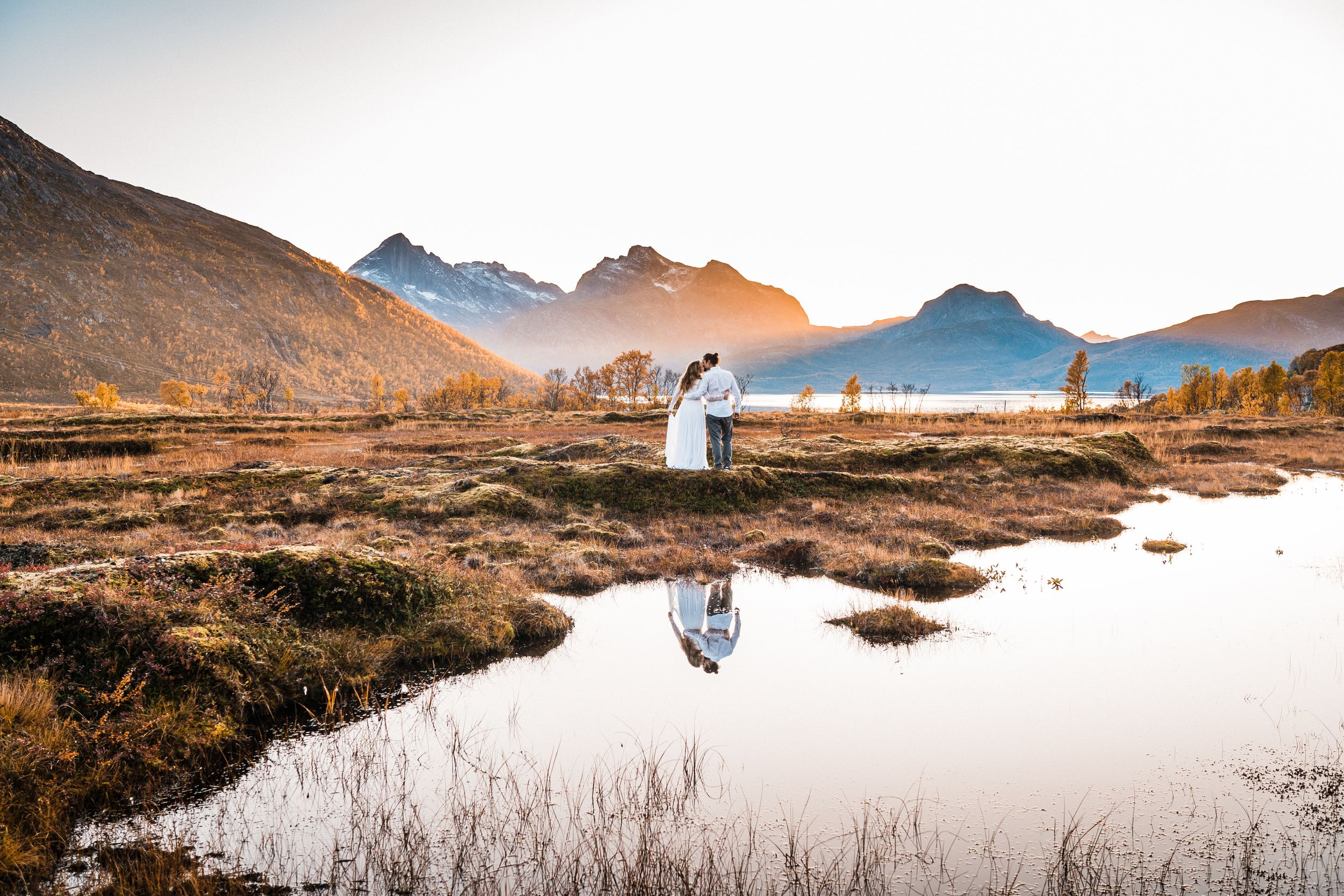 Photographer Maria Karlsson Swedish Adventure Elopement Couple and mountains in Tromsö Norway fall autumn reflection
