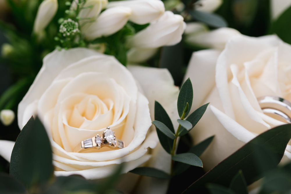 engagement ring in white roses