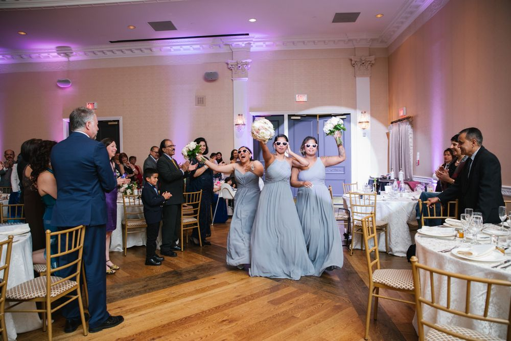 Bridesmaids entering reception