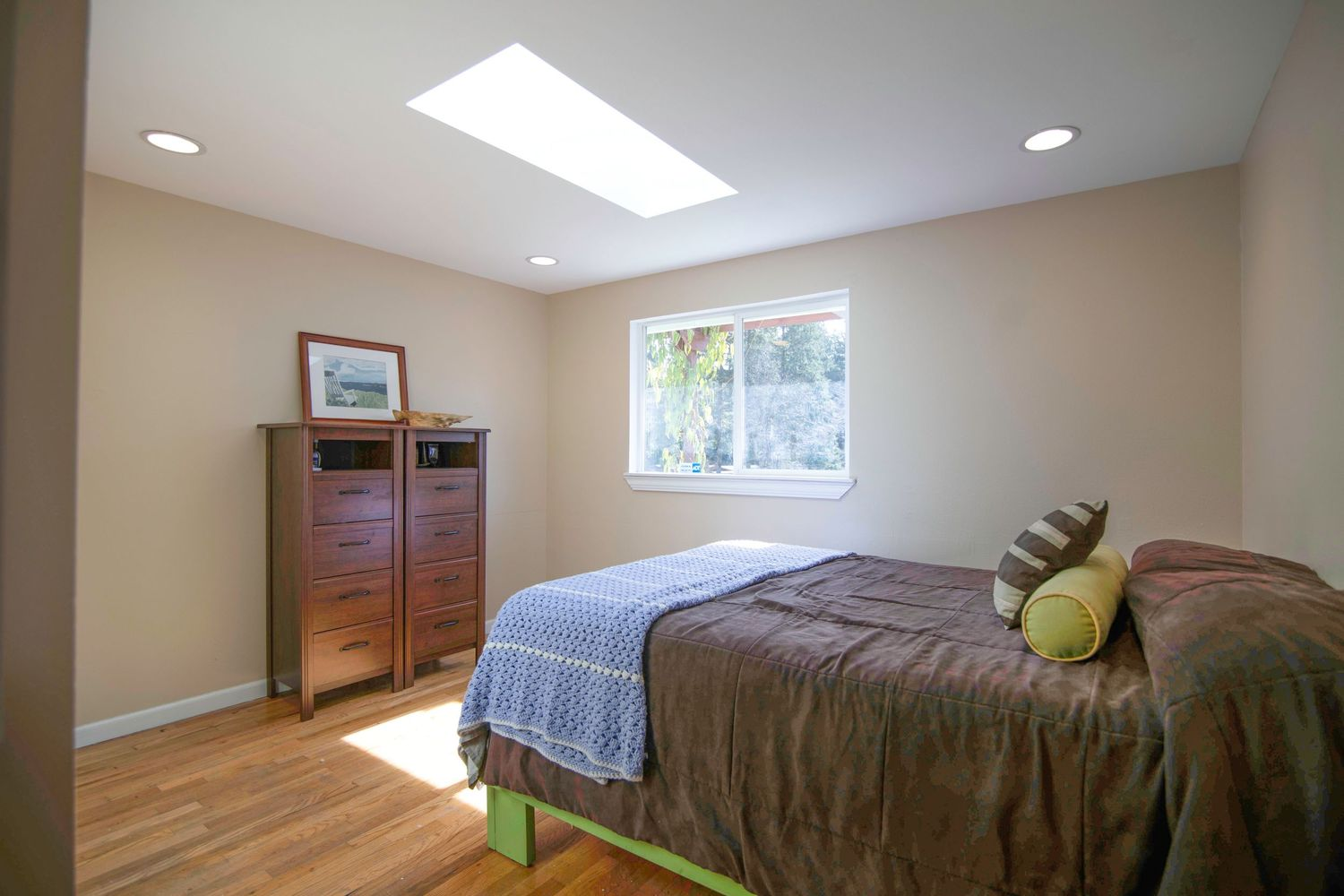 inside of a bedroom with a bright window