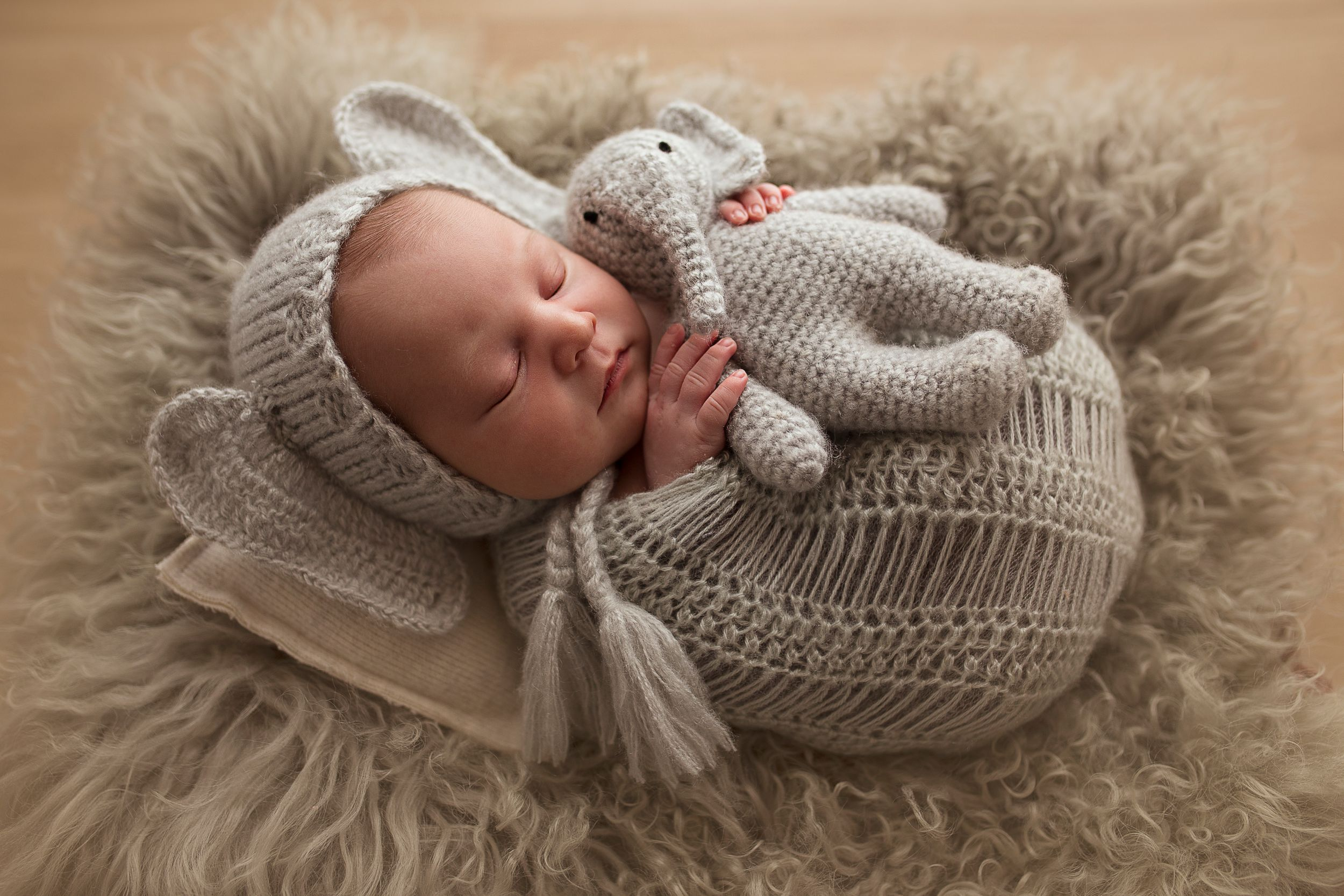 baby boy in elephant suit newborn child sleeping