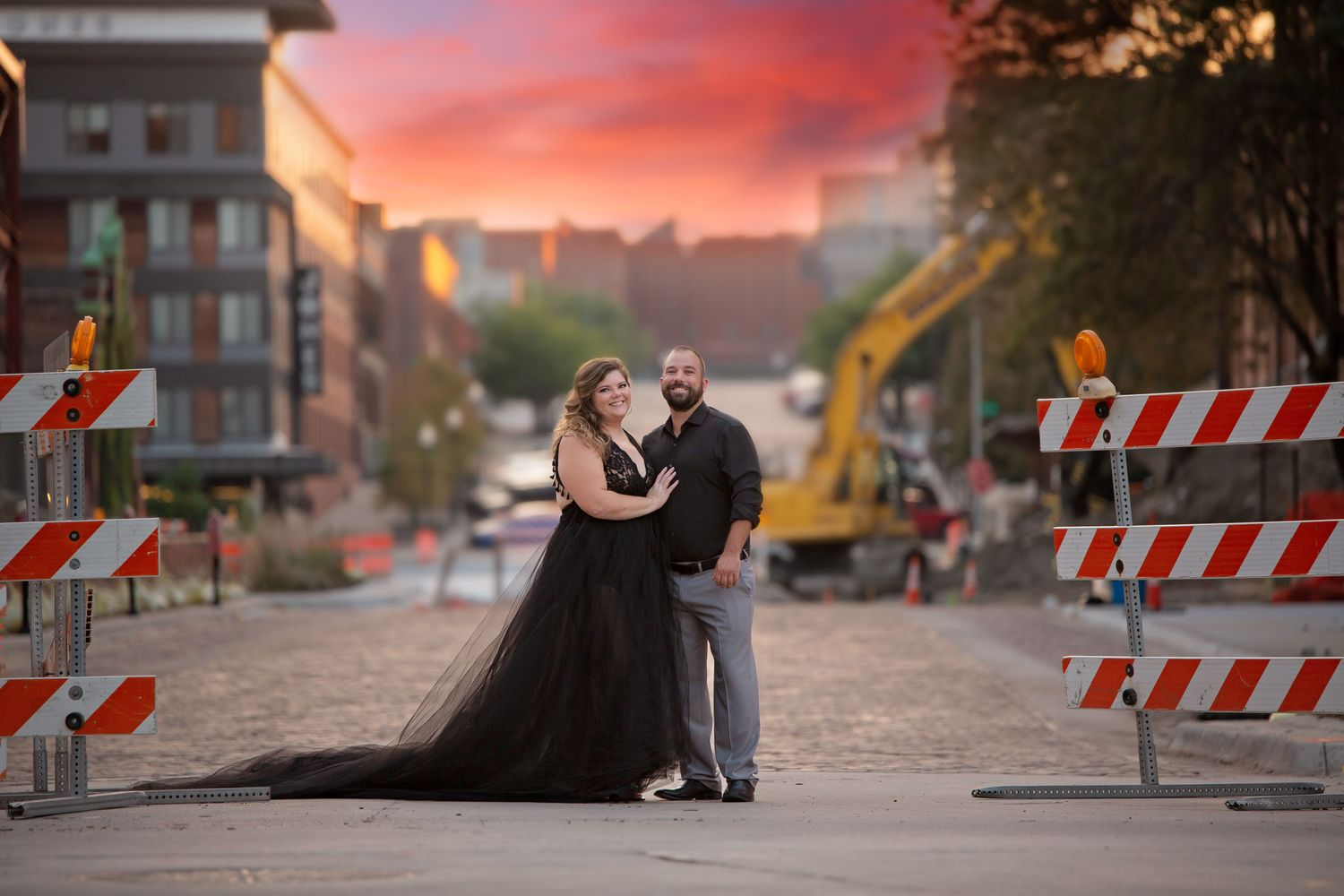 A couple poses in between construction barriers in the Old Market.