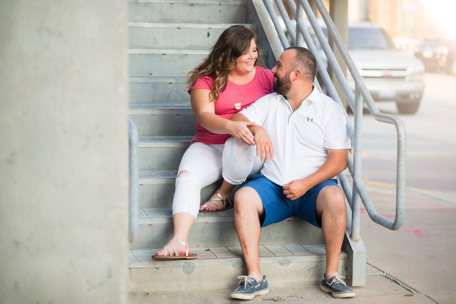 Omaha engaged couple poses on the stairs of a parking garage in the Old Market