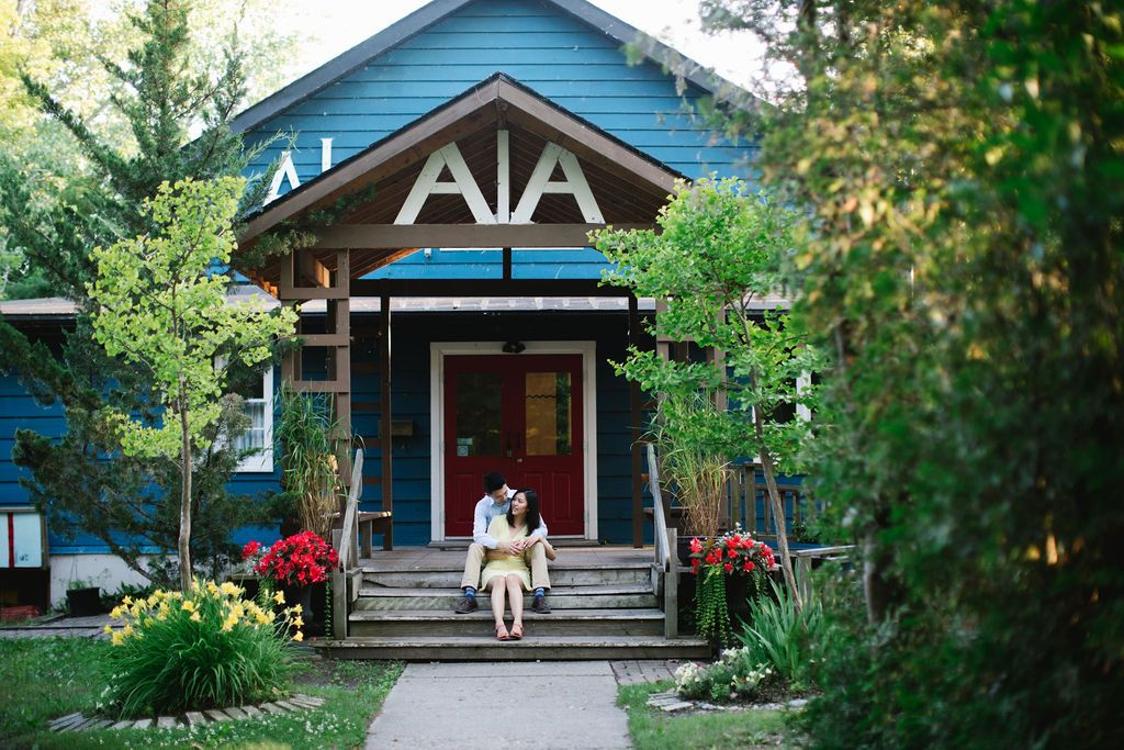 algonquin island association club house couple sitting and hugging engagement session