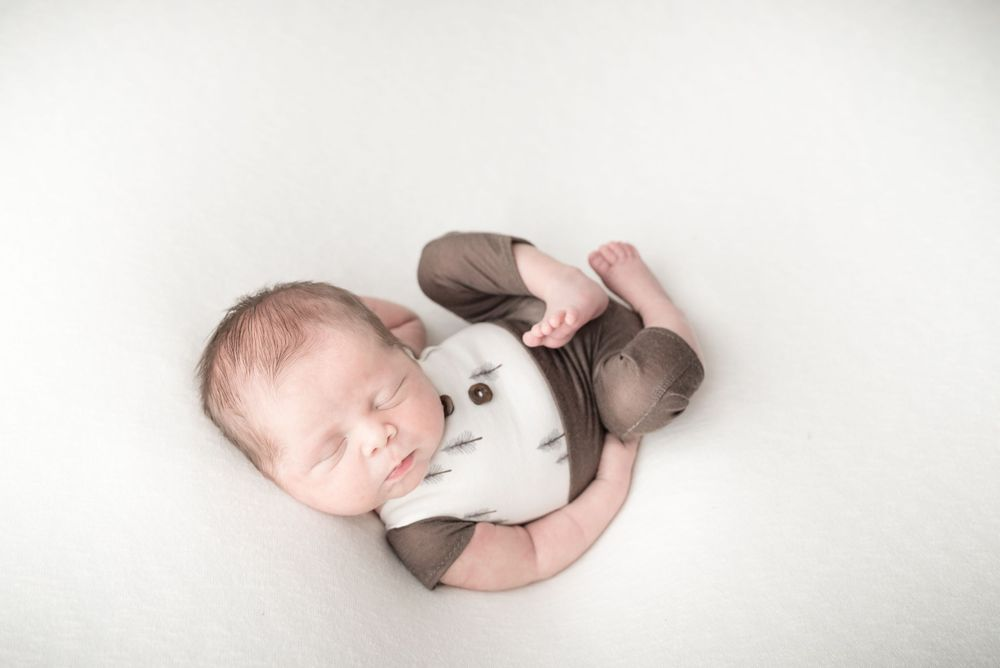 Photo of posed newborn baby boy in Irvine, CA