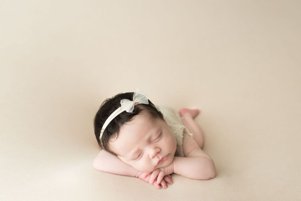 Photo of posed newborn baby girl in Irvine, CA