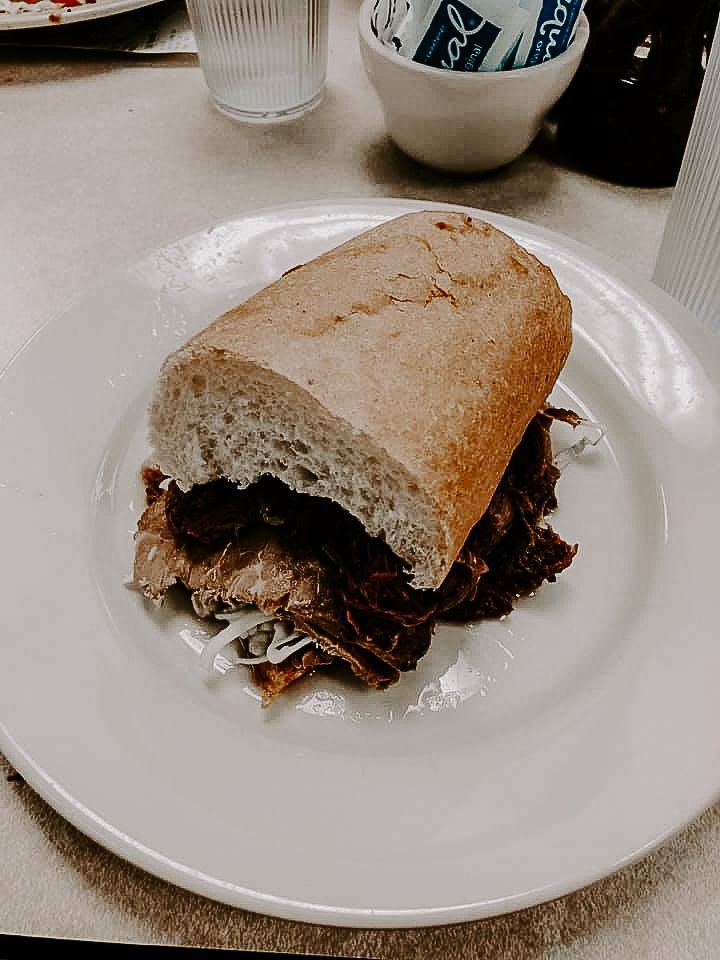 sandwich from Mulate's during an urban elopement in New Orleans