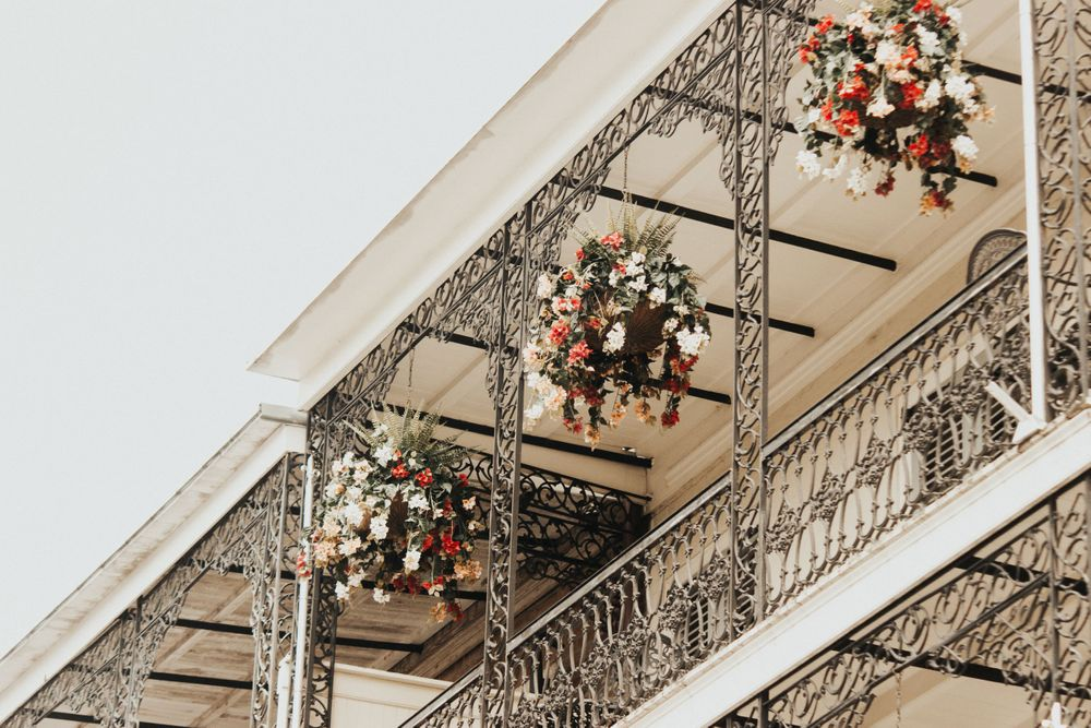 floral arrangements hanging from a second story balcony in New Orleans