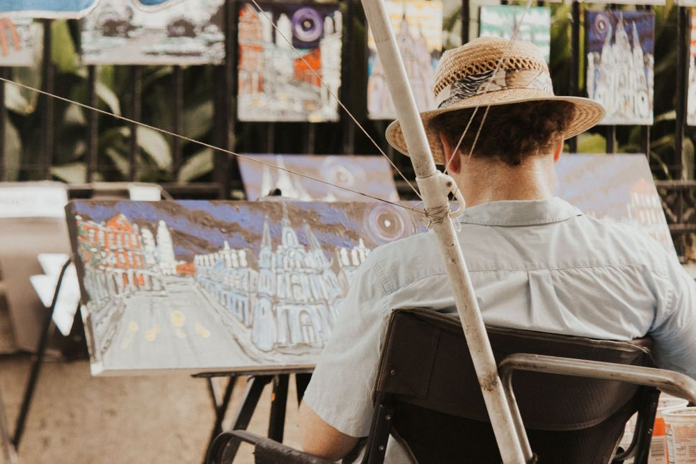 artist working in Jackson Square during a New Orleans Elopement